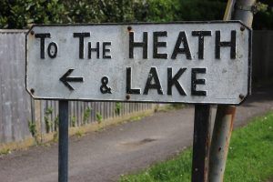 sign reading to the heath and lake