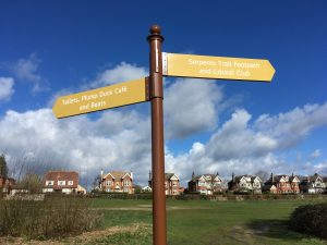finger post sign indicating left the the cafe and boats and right for the serpents trail and cricket club