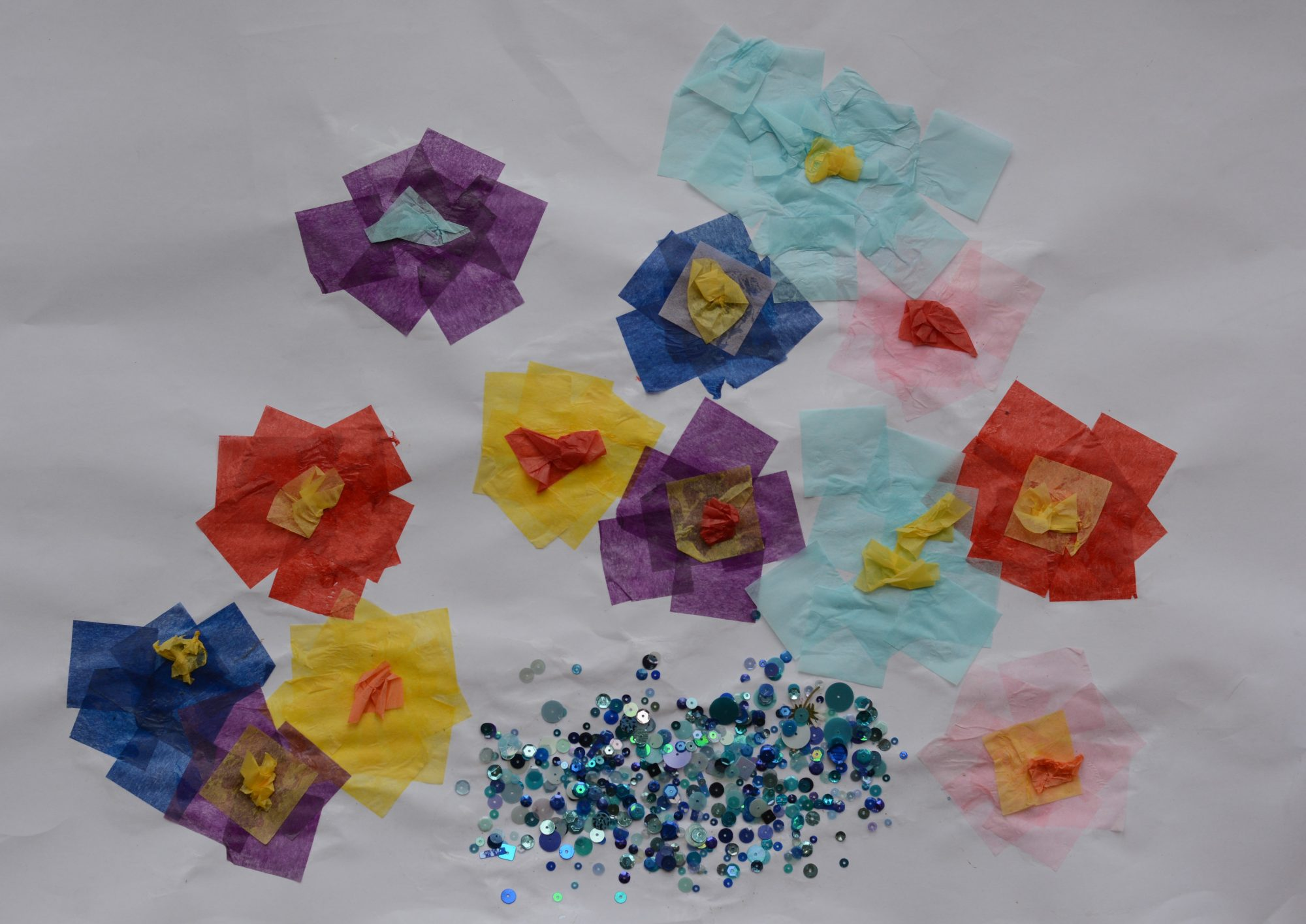 flower collage using coloured tissue paper and sequins