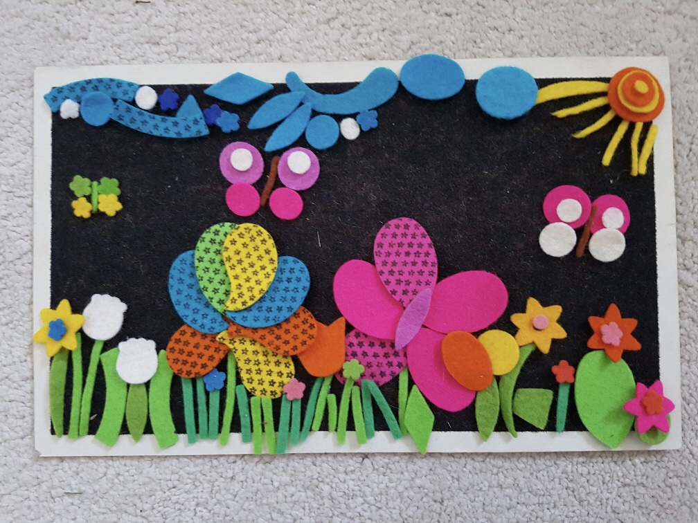 Fuzzy felt flower garden with butterflies