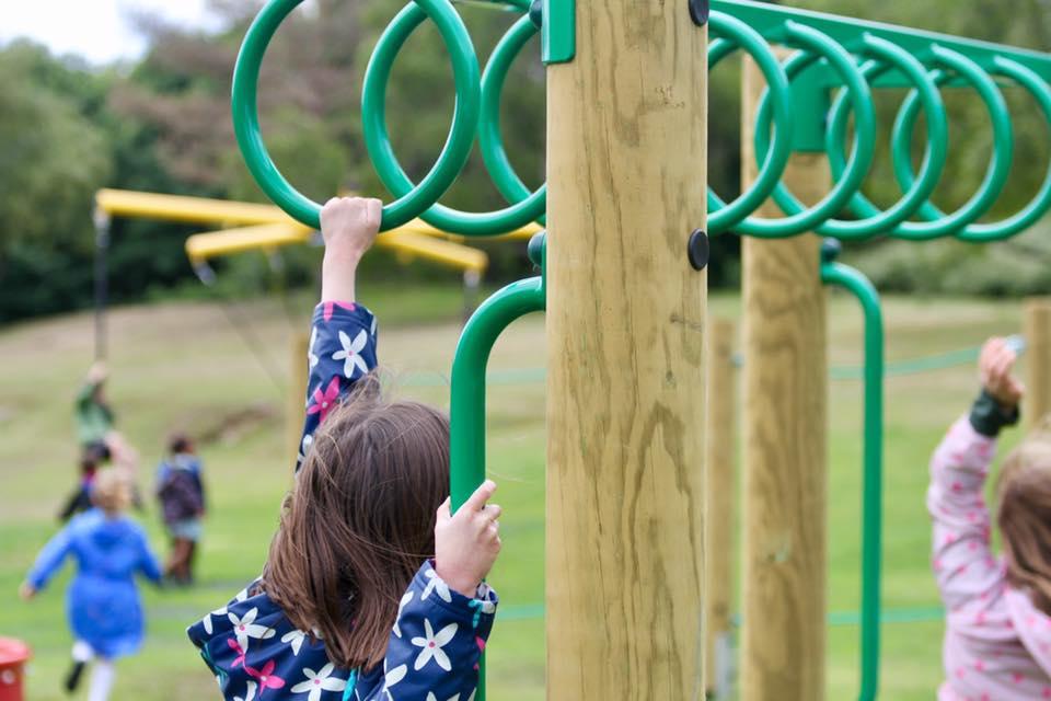 child playing on playground equipment